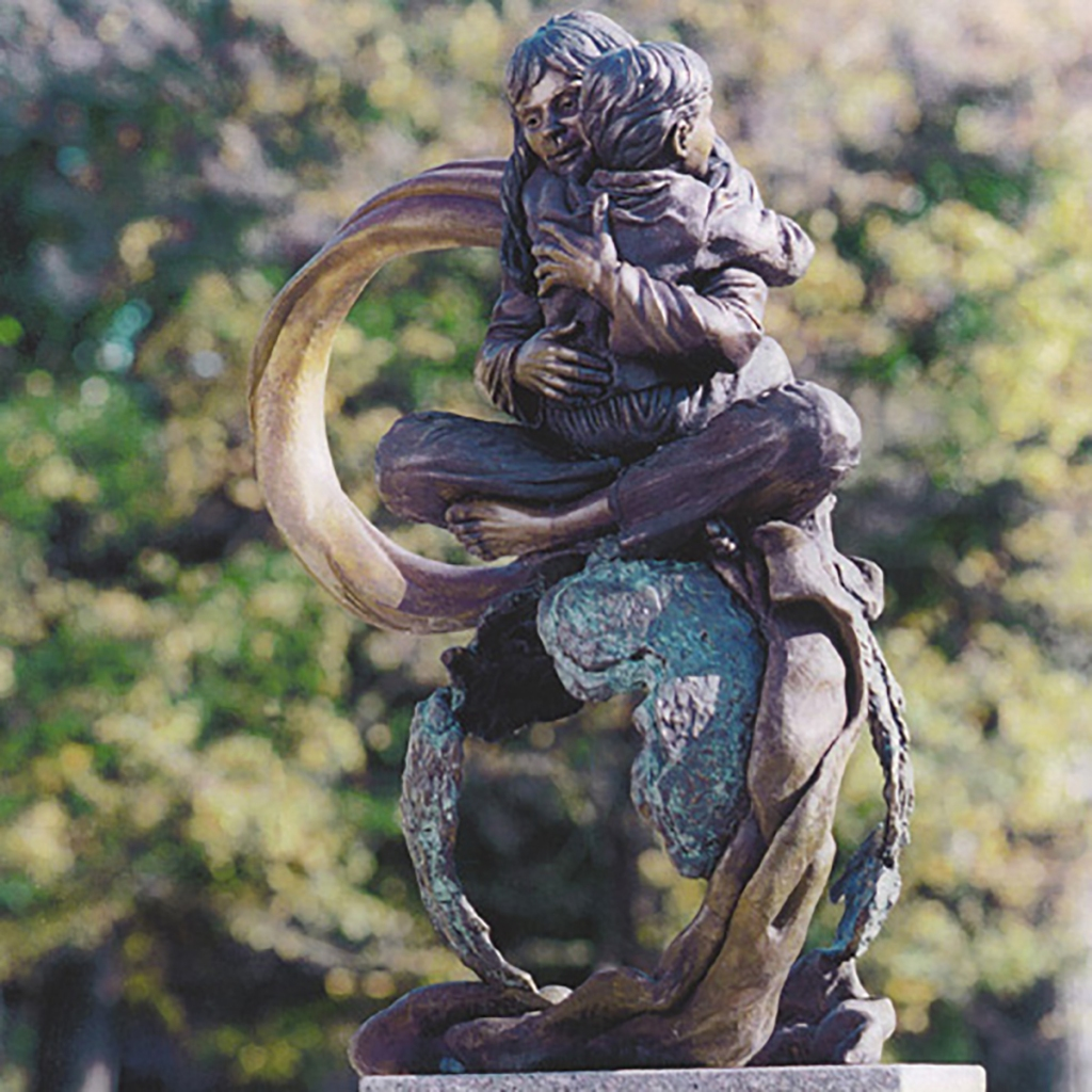 Compassion Moves a World, a bronze memorial sculpture by artist Julie Rotblatt-Amrany in Highland Park, IL