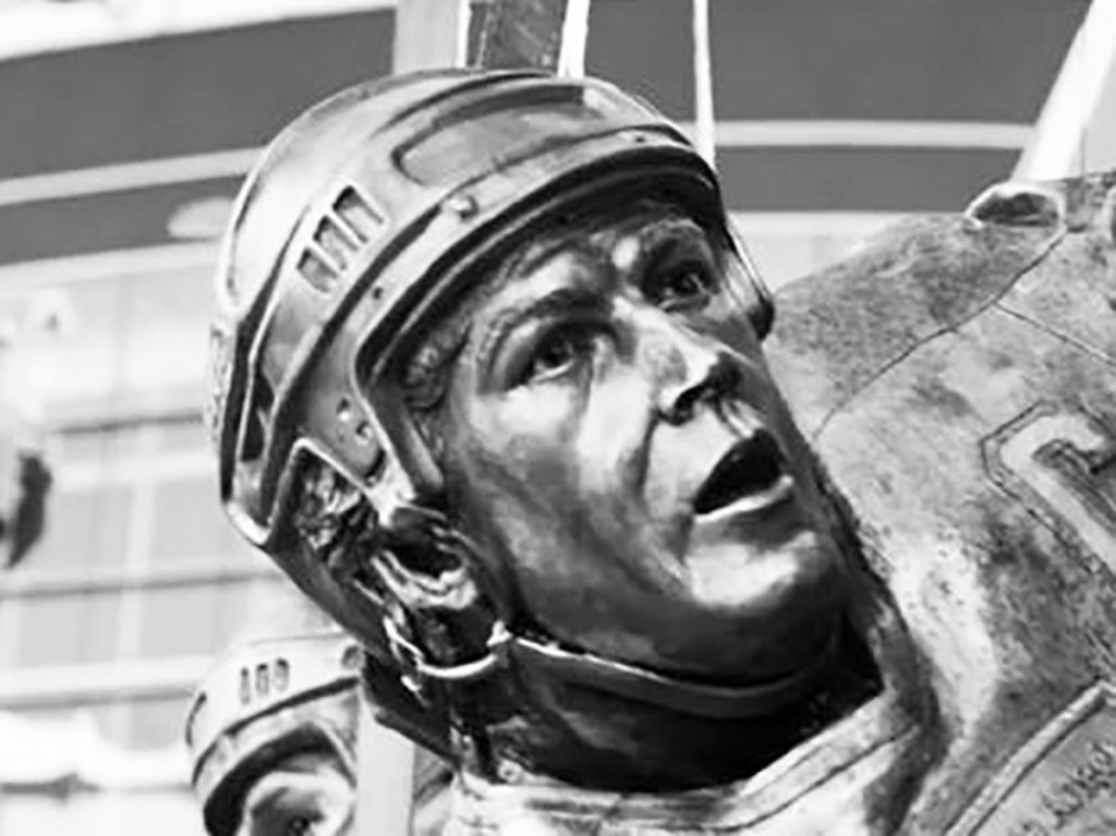 Bronze sculpture of Dave Taylor by Julie Rotblatt-Amrany for LA Kings 50th Anniversary Monument at Staples Center