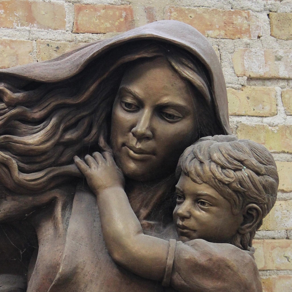 Madonna and Child, a bronze sculpture for Mt. Carmel High School by artist Julie Rotblatt-Amrany